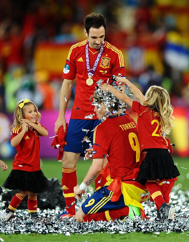 KIEV, UKRAINE - JULY 01: The players' children play in the confetti with Fernando Torres and Juanfran of Spain during the UEFA EURO 2012 final match between Spain and Italy at the Olympic Stadium on July 1, 2012 in Kiev, Ukraine. (Photo by Laurence Griffiths/Getty Images)