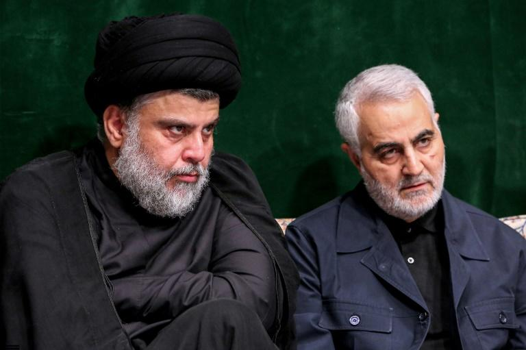 Moqtada Sadr sits alongside Major General Qasem Soleimani, a key Revolutionary Guards commander who served as adviser during Iraq's war against the Islamic State group and remains a key powerbroker among its Shiite factions