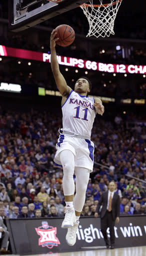 Kansas' Devon Dotson shoots during the first half of an NCAA college basketball game against Texas in the Big 12 men's tournament Thursday, March 14, 2019, in Kansas City, Mo. (AP Photo/Charlie Riedel)