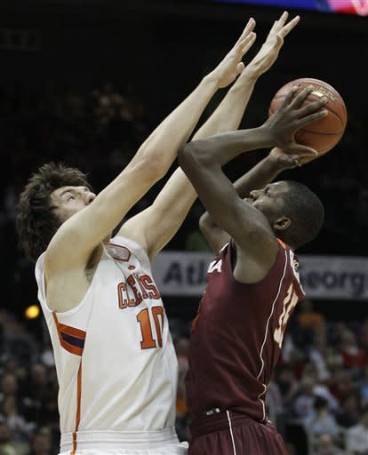 Virginia Tech forward Dorian Finney-Smith (15) heads to the basket as Clemson center Catalin Baciu (10) defends during the first half of an NCAA college basketball game in the first round of the Atlantic Coast Conference men's tournament, Thursday, March 8, 2012, in Atlanta. (AP Photo/Chuck Burton)