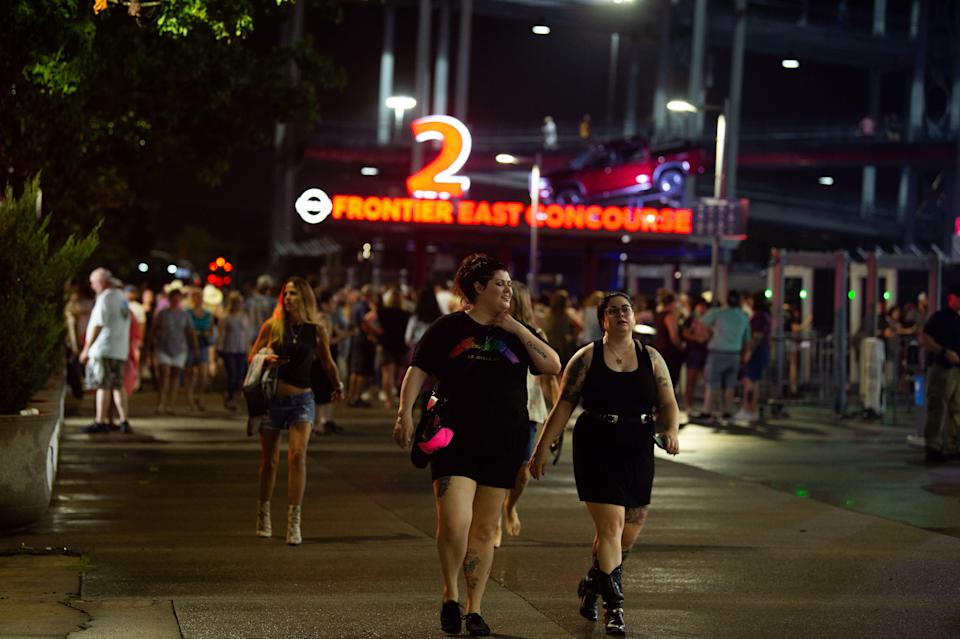 Fans leave the stadium after hearing the Garth Brooks concert has been postponed due to weather at Nissan Stadium in Nashville, Tenn., Saturday, July 31, 2021.
