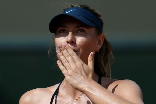 Sealed with a kiss: Maria Sharapova celebrates after victory over Donna Vekic in the French Open second round