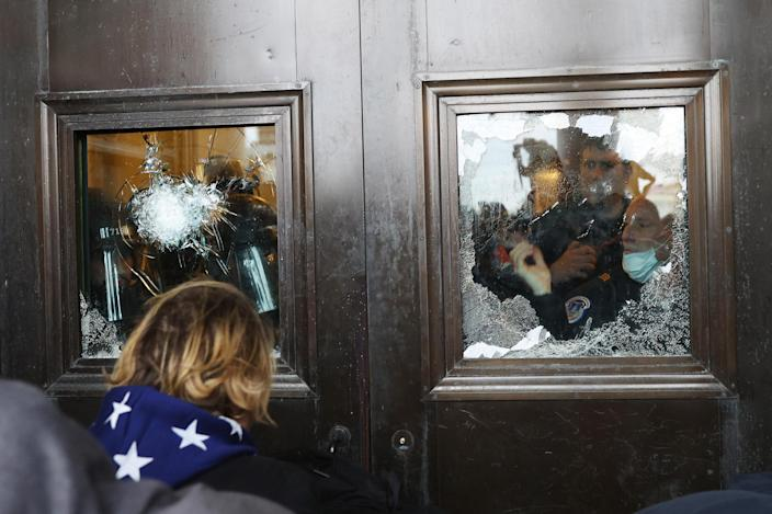 Image: A Capitol police officer at the U.S. Capitol on Jan. 6 (Tasos Katopodis / Getty Images file)