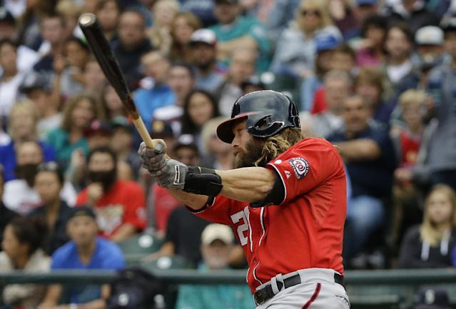 Washington Nationals' Jayson Werth hits a two-run home run against the Seattle Mariners in the first inning of a baseball game, Saturday, Aug. 30, 2014, in Seattle. (AP Photo/Ted S. Warren)