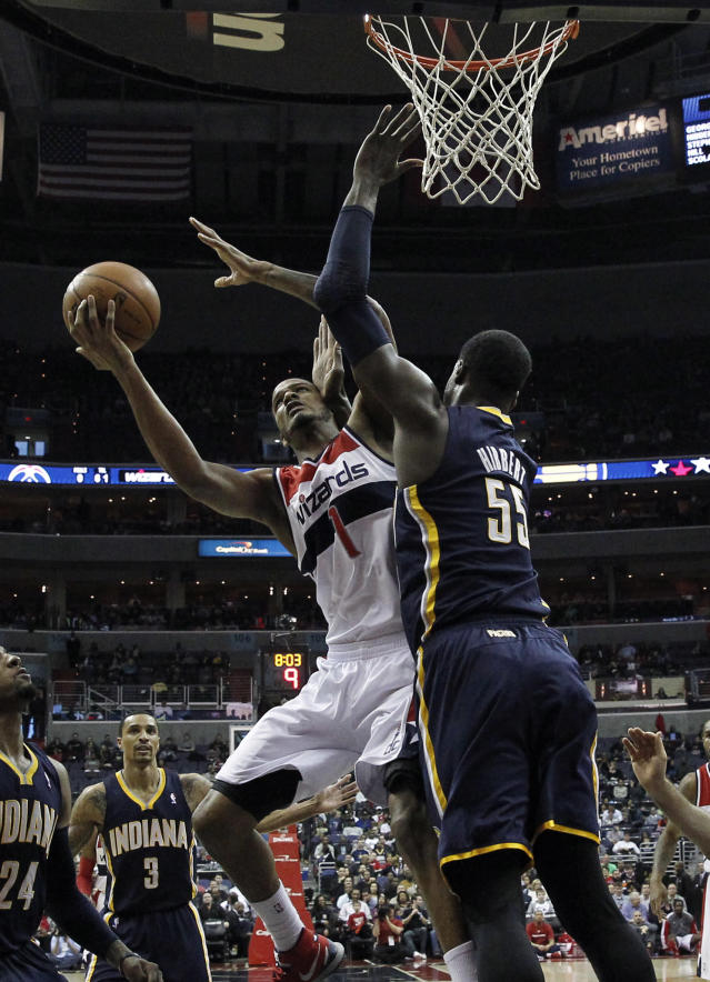 Washington Wizards forward Trevor Ariza (1) tries to shoot over Indiana Pacers center Roy Hibbert (55) in the first half of an NBA basketball game on Friday, March 28, 2014, in Washington. (AP Photo/Alex Brandon)