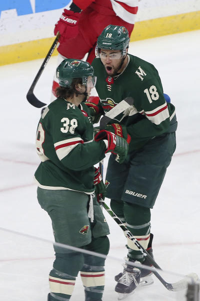 Minnesota Wild's Jordan Greenway, right, celebrates with Minnesota Wild's Ryan Hartman after scoring against Detroit Red Wings' goalie Jimmy Howard in the first period of an NHL hockey game Wednesday, Jan. 22, 2020, in St. Paul, Minn. (AP Photo/Jim Mone)
