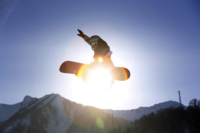 Czech Republic's Sarka Pancochova takes a jump during the women's snowboard slopestyle qualifying at the Rosa Khutor Extreme Park ahead of the 2014 Winter Olympics, Thursday, Feb. 6, 2014, in Krasnaya Polyana, Russia. (AP Photo/Sergei Grits)