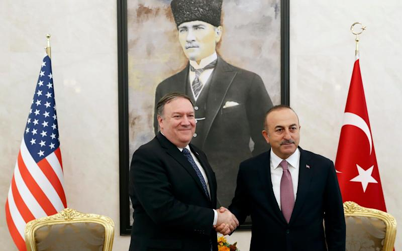 Mike Pompeo shakes hands with Turkish Foreign Minister Mevlut Cavusoglu before their talks in Ankara - pool reuters