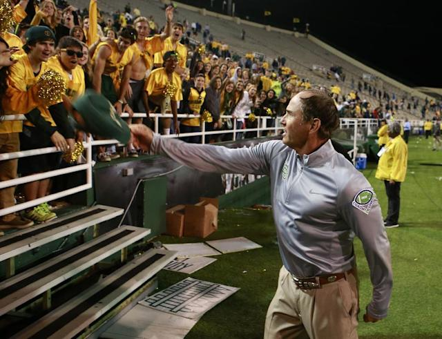 Baylor coach Art Briles throws his hat to the crowd following an NCAA college football game against West Virginia, Saturday, Oct. 5, 2013, in Waco, Texas. Baylor won 73-42. (AP Photo/Jose Yau)
