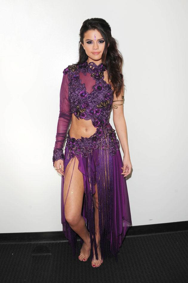 Selena Gomez wore this revealing dress with a thigh-high split for a performance of her new single. Copyright [Rex]
