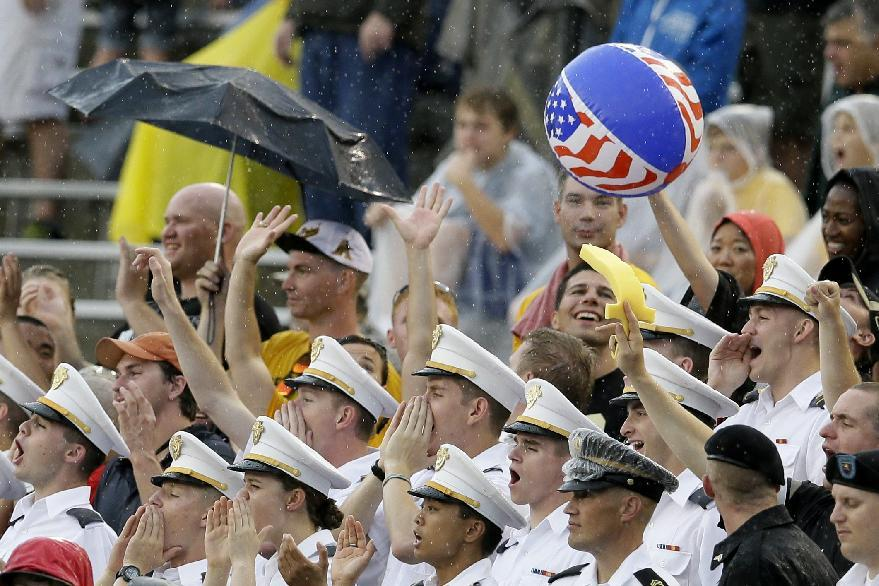 A light rain falls as Army cadets cheer on their team and toss a beach ball through the stands in the first half of an NCAA college football game against Louisiana Tech, Saturday, Sept. 28, 2013, in Dallas. (AP Photo/Tony Gutierrez)
