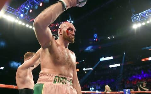 <span>Fury was cut badly above the right eye from a left hook in the third round</span> <span>Credit: Getty Images </span>