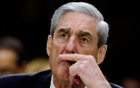 FILE PHOTO: Robert Mueller, as FBI director, listens during a U.S. Senate Judiciary Committee oversight hearing about the Federal Bureau of Investigation on Capitol Hill in Washington, June 19, 2013. REUTERS/Larry Downing/File Photo