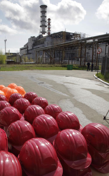 Helmets of construction workers are readied near the destroyed reactor of the Chernobyl nuclear power plant in Chernobyl, Ukraine, Thursday, April 26, 2012. Ukraine's president on Thursday thanked the international community for financing the construction of a new, safer shelter over the damaged Chernobyl reactor and urged extreme caution with nuclear energy as Ukrainians, Belarusians and Russians marked the 26th anniversary of the world's worst nuclear disaster. (AP Photo/ Efrem Lukatsky)