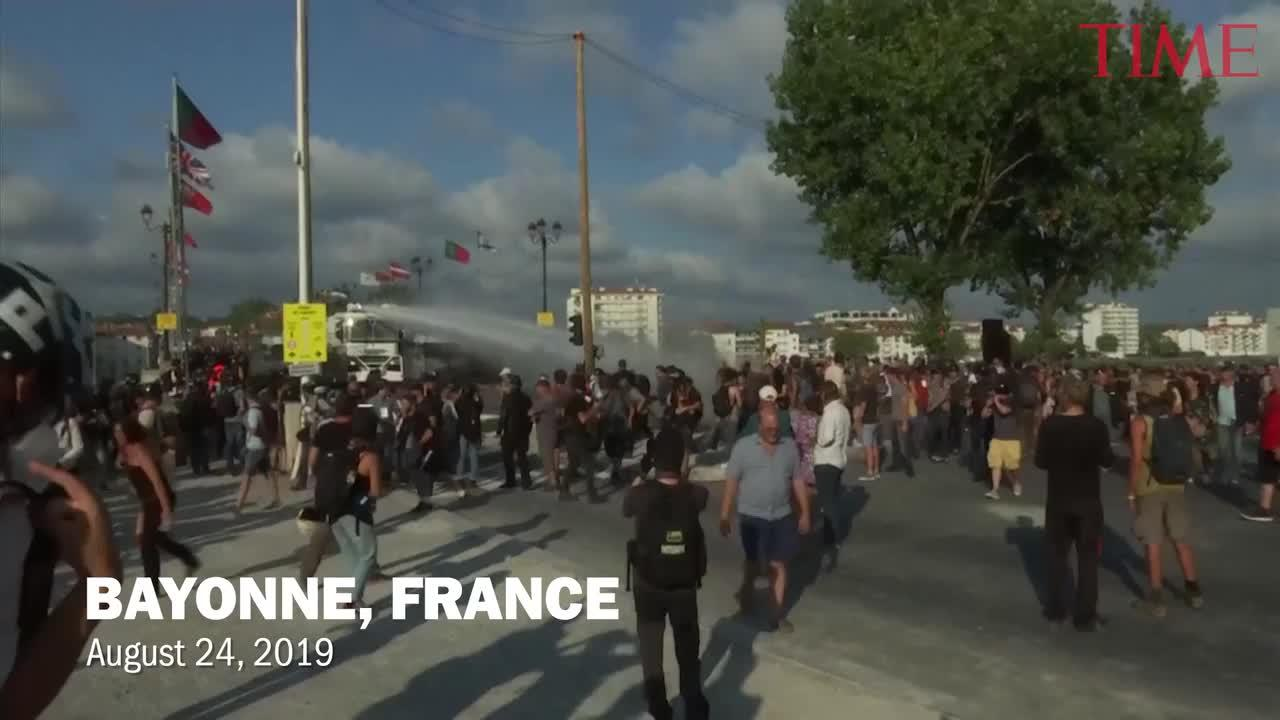 Police have fired water cannon at about 400 anti-capitalist protesters blocking roads in a town near the venue of the G-7 summit in southwest France.