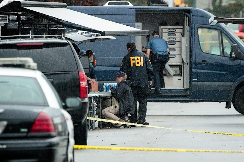Members of the Federal Bureau of Investigation (FBI) work at the site where Ahmad Khan Rahami was arrested after a shootout with police, September 19, 2016 in Linden, New Jersey