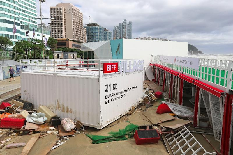 Debris from the Busan International Film Festival (BIFF) village is seen along Haeundae beach in the aftermath of typhoon Chaba, on October 5, 2016 (AFP Photo/Yonhap)