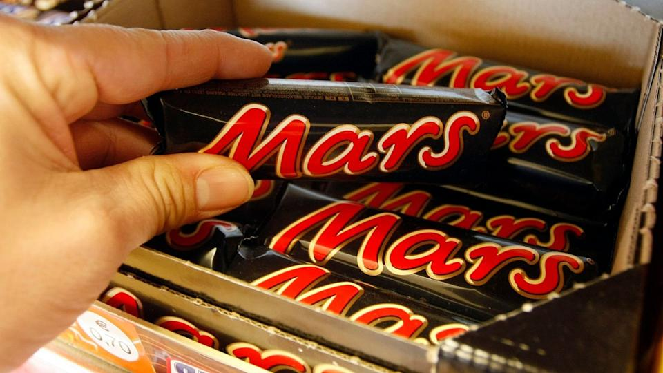 Mandatory Credit: Photo by Martin Meissner/AP/Shutterstock (7071798a)Chocolate bars from Mars are pictured in a store in Gelsenkirchen, Germany.
