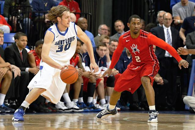 Saint Louis' Jake Barnett (30) heads to the basket as Richmond's Cedrick Lindsay (2) defends during the first half of an NCAA college basketball game Wednesday, Jan. 29, 2014, in St. Louis. (AP Photo/Scott Kane)