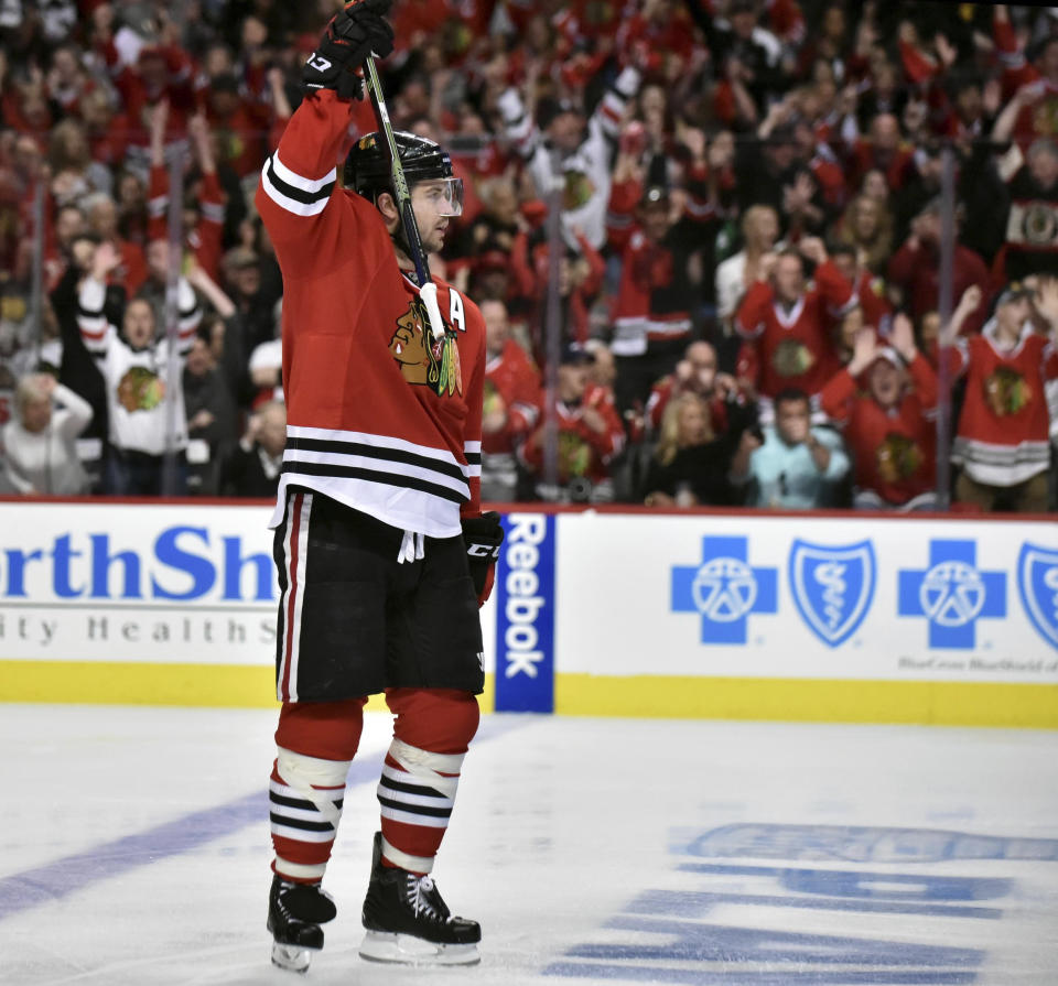 FILE - Chicago Blackhawks defenseman Brent Seabrook reacts to his first period goal against the St. Louis Blues in Game 3 of an NHL hockey first-round Stanley Cup playoff series in Chicago, in this Sunday, April 17, 2016, file photo. Longtime Chicago Blackhawks defenseman and three-time Stanley Cup winner Brent Seabrook announced Friday, March 5, 2021, he's unable to continue playing hockey because of injury. (John Starks/Daily Herald via AP, File)
