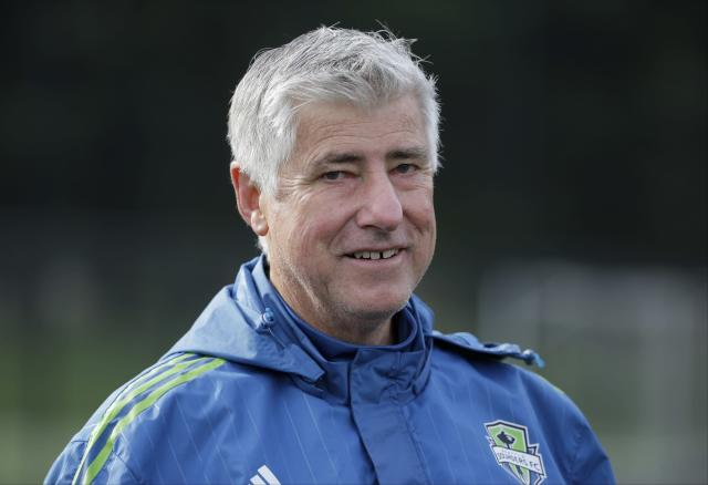 FILE - In this Oct. 27, 2015, file photo, Seattle Sounders coach Sigi Schmid walks off the field following an MLS soccer training session in Tukwila, Wash. Schmid, the winningest coach in MLS history, has died. He was 65. Schmid's family said he died Tuesday, Dec. 25, 2018, at Ronald Reagan UCLA Medical Center in Los Angeles. Schmid was hospitalized three weeks ago as he awaited a heart transplant. (AP Photo/Ted S. Warren, File)