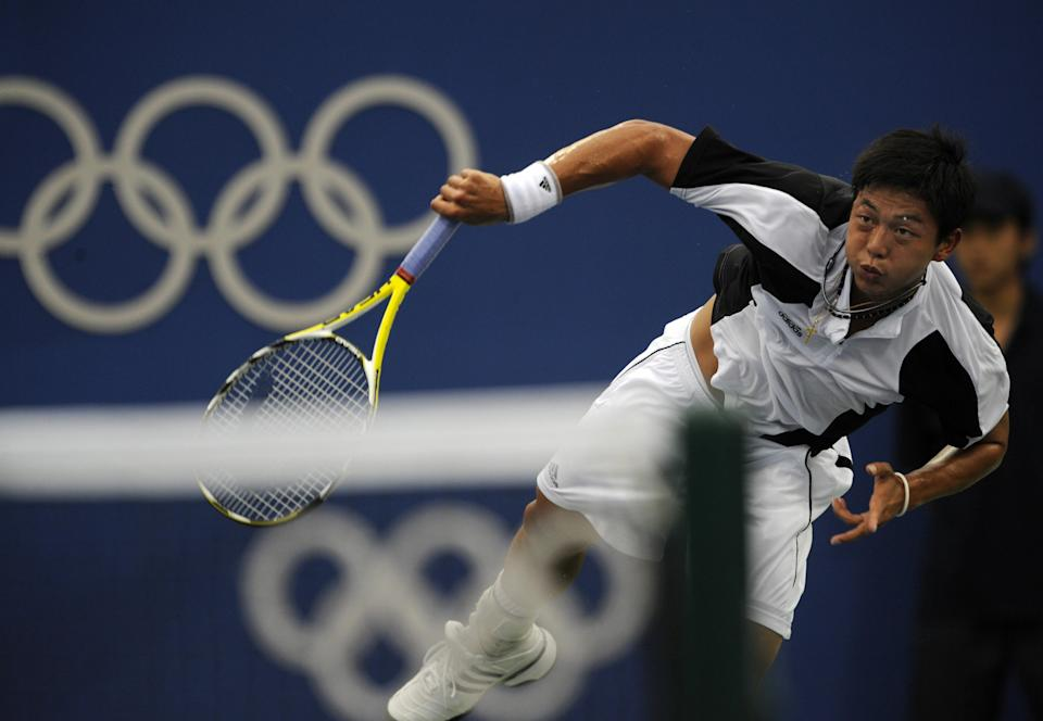 Yen-Hsun Lu from Taiwan returns a ball to Andy Murray from Great Britain during the men's singles first round tennis match against at the 2008 Beijing Olympic Games in Beijing on August 11, 2008. Lu won the match. AFP PHOTO/PEDRO UGARTE  (Photo credit should read PEDRO UGARTE/AFP via Getty Images)