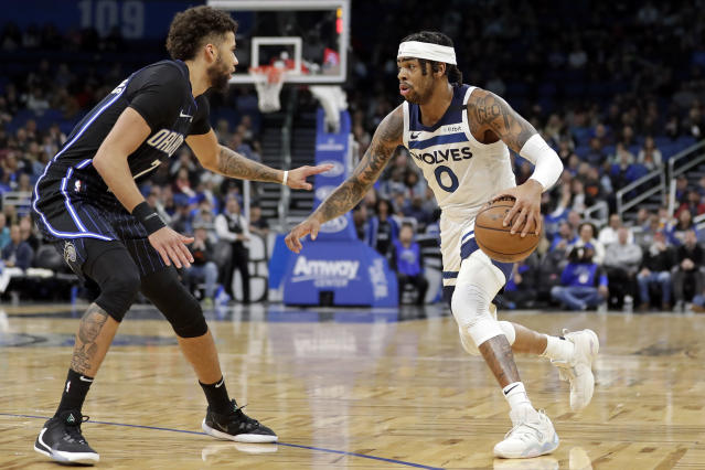 Minnesota Timberwolves guard D'Angelo Russell (0) looks to get around Orlando Magic guard Michael Carter-Williams during the first half of an NBA basketball game Friday, Feb. 28, 2020, in Orlando, Fla. (AP Photo/John Raoux)