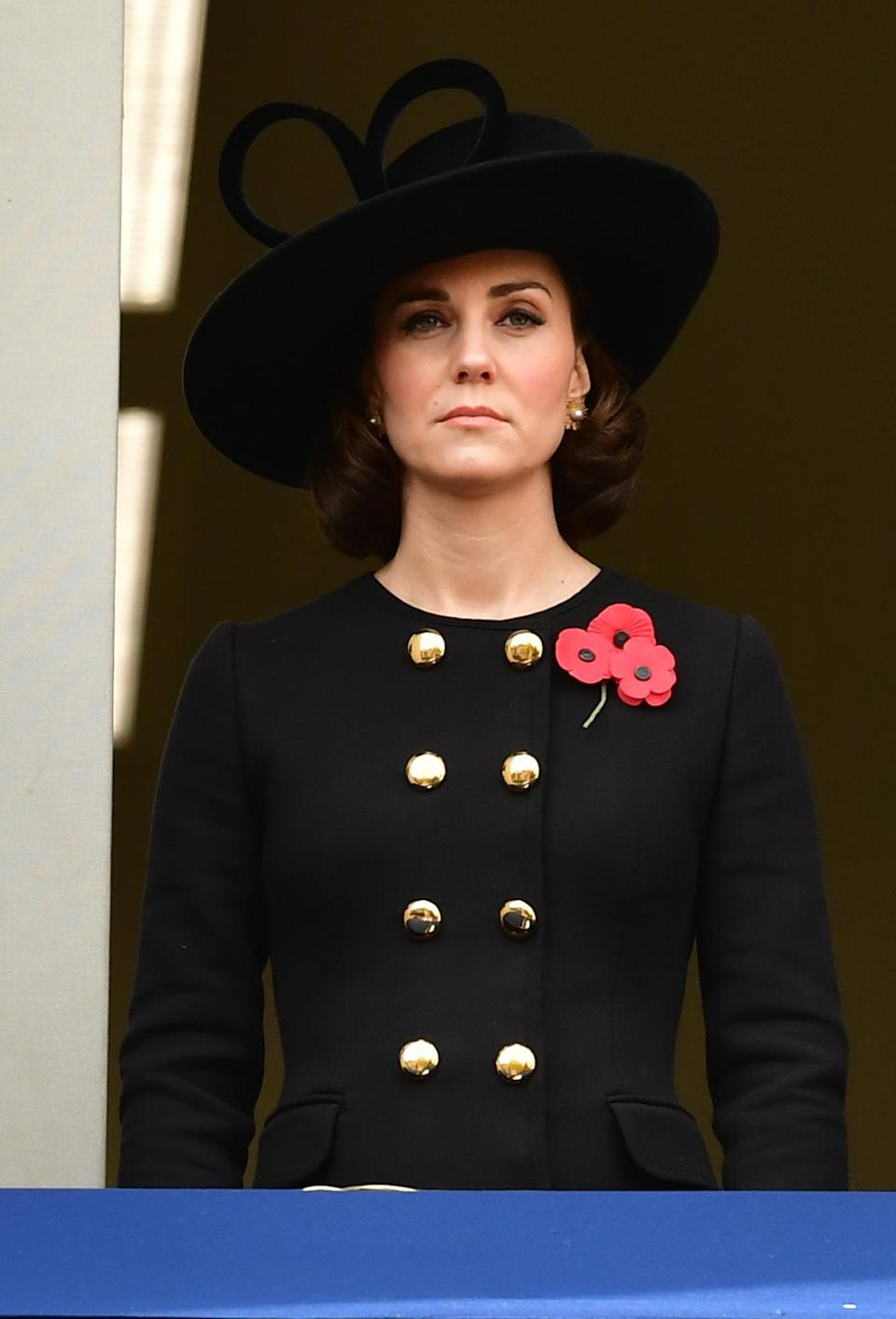 <p>Wearing a hat she's owned for over a decade and a chic, double breasted black coat dress, the Duchess looked suitably subtle and sophisticated for the Remembrance Sunday service in London. <em>[Photo: PA]</em> </p>