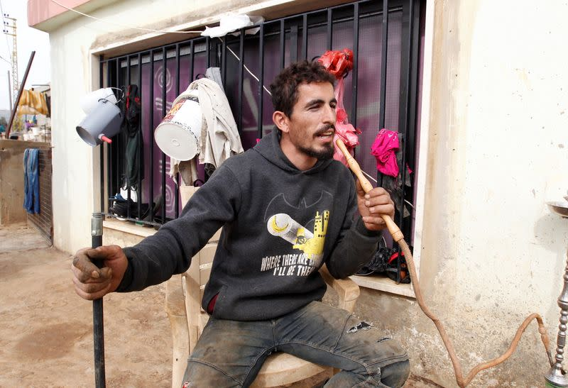 A Lebanese villager, Kamal al-Ahmad, who claims that Israeli soldiers took cows he owned, is pictured in the village of Wazzani
