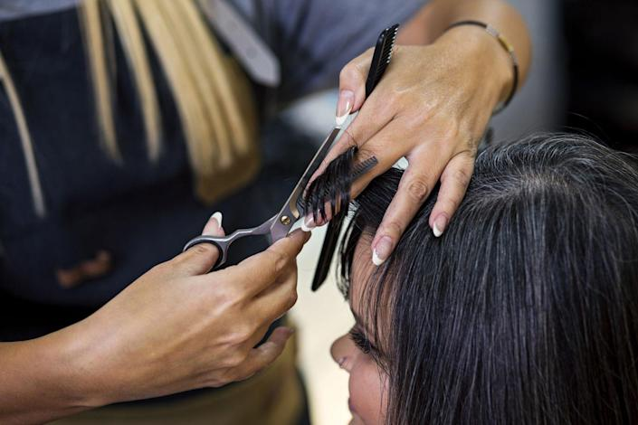 """<p>If DIY-ing a haircut sounds too scary, you still have another (cheaper) option. Make an appointment at a <a href=""""https://www.thefrugalgirl.com/zoe-and-i-tried-a-beauty-school-heres-how-it-went/"""" rel=""""nofollow noopener"""" target=""""_blank"""" data-ylk=""""slk:professional salon school"""" class=""""link rapid-noclick-resp"""">professional salon school</a> where you'll get worked on by a student stylist who's being trained by an instructor. </p>"""