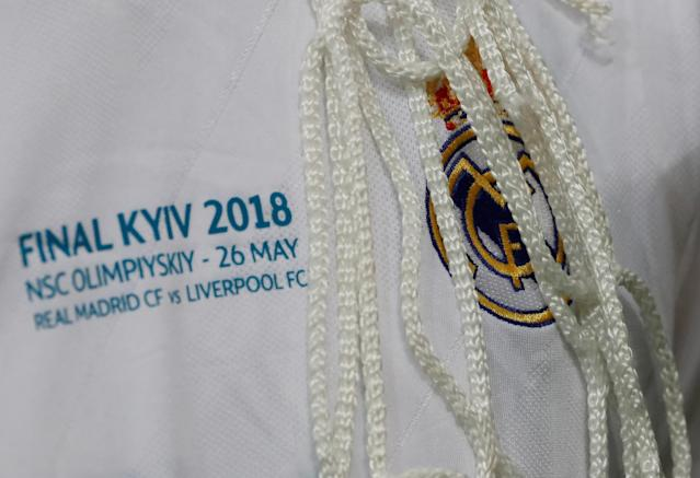 Soccer Football - Champions League Final - Real Madrid v Liverpool - NSC Olympic Stadium, Kiev, Ukraine - May 26, 2018 Real Madrid's Marcelo celebrates with a piece of the goal net after winning the Champions League REUTERS/Andrew Boyers