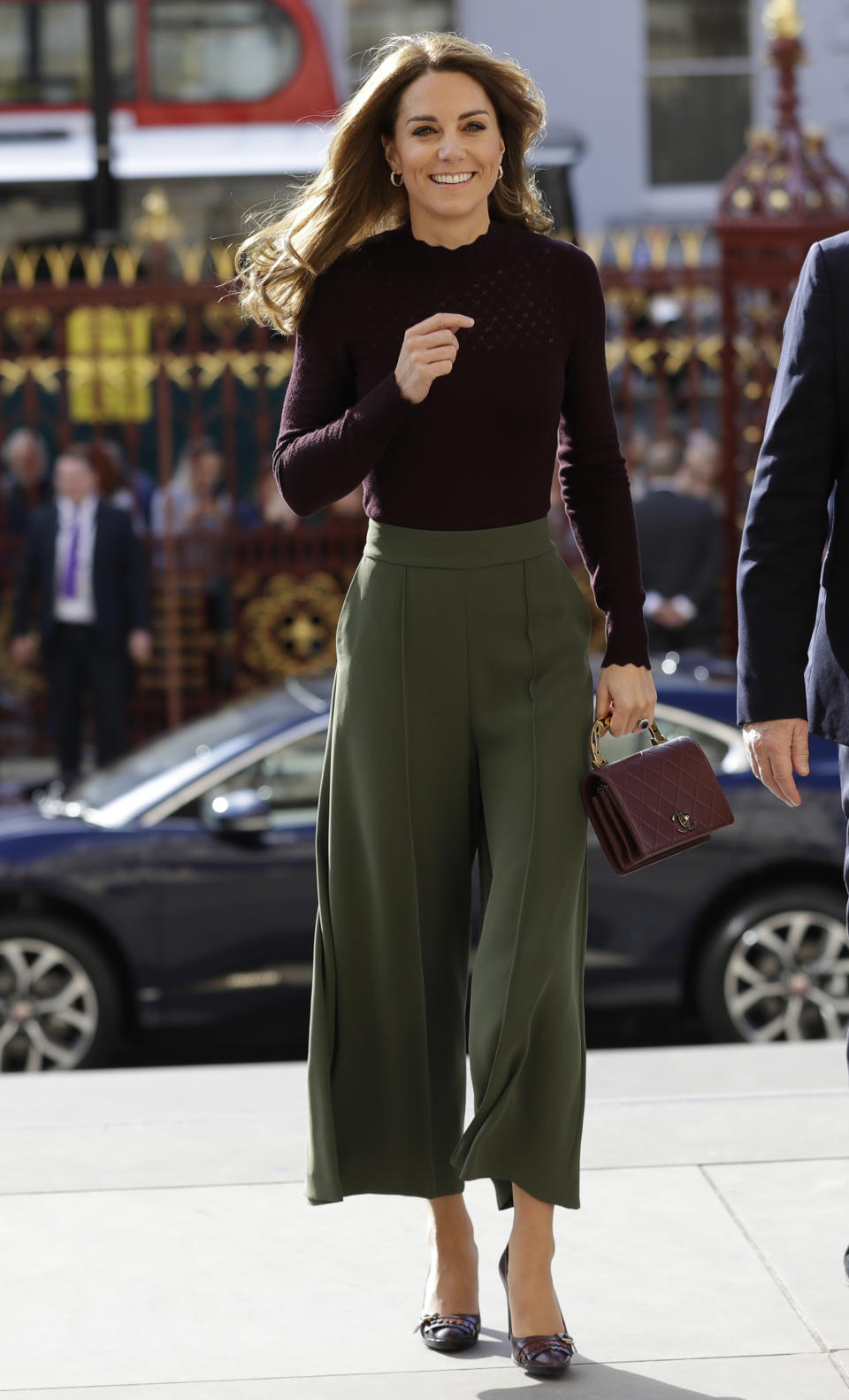 The Duchess of Cambridge arrived at The Natural History Museum wearing Jigsaw trousers and a Warehouse jumper. [Photo: Getty]