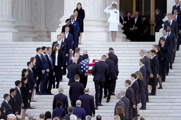 PHOTO: Members of the U.S. Supreme Court police serving as pallbearers carry the casket of the late Associate Justice John Paul Stevens through a cordon of former law clerks and up the steps of the U.S. Supreme Court, July 22, 2019, in Washington, DC. (Alex Wong/Getty Images)
