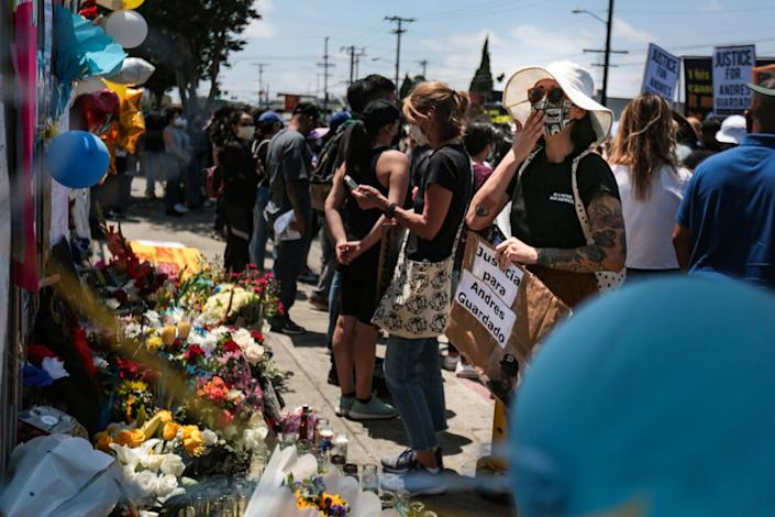 At the rally for Andres Guardado, mourners pay their respects at a makeshift memorial in his honor.
