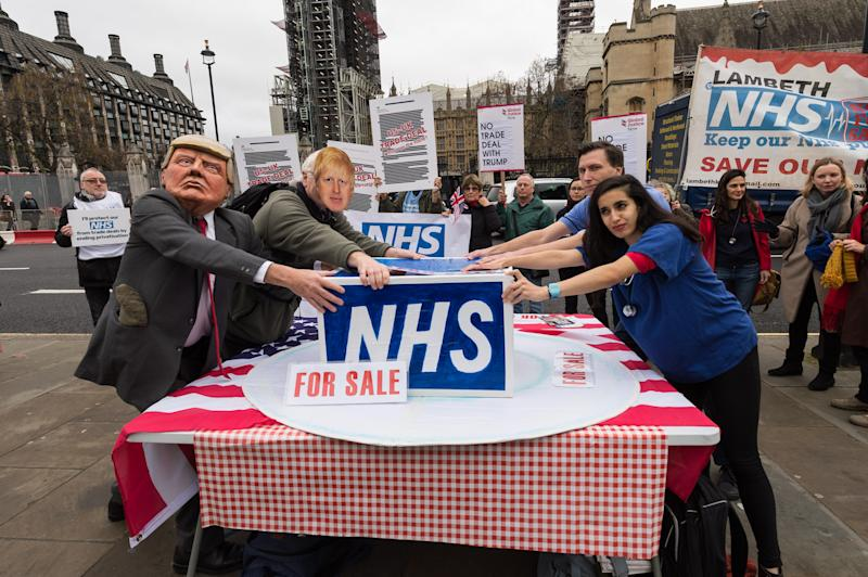 Protesters wearing masks of Donald Trump and Boris Johnson together with campaigners for keeping the National Health Service (NHS) publicly owned gather outside the Houses of Parliament to demand an end of privatisation of healthcare in the NHS on November 25, 2019 in London, England. Photo: WIktor Szymanowicz/NurPhoto
