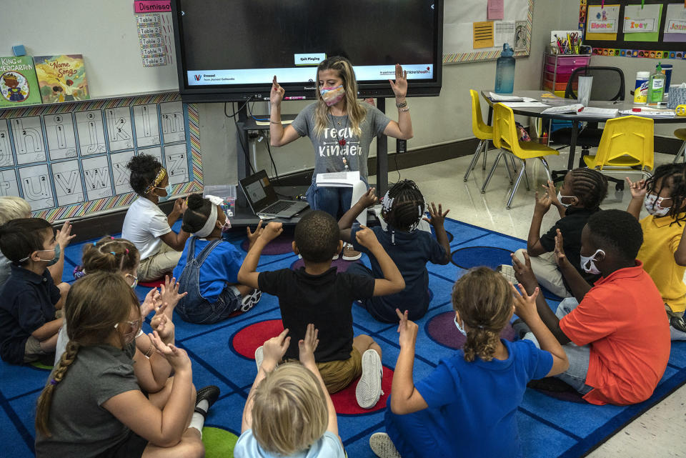 Kindergarten teacher Mrs. Amber Updegrove interacts with her students at Warner Arts Magnet Elementary in Nashville, Tenn, on Friday, Aug. 20, 2021. All of her students were masked up at the school. (AP Photo/John Partipilo)