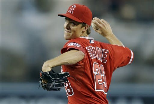 Los Angeles Angels starting pitcher Zack Greinke throws to the Boston Red Sox during first inning of a baseball game in Anaheim, Calif., Thursday, Aug. 30, 2012. (AP Photo/Chris Carlson)