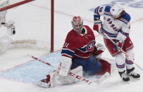 New York Rangers' Brendan Lemieux scores against Montreal Canadiens goaltender Carey Price during the second period of an NHL hockey game Saturday, Nov. 23, 2019, in Montreal. (Graham Hughes/The Canadian Press via AP)
