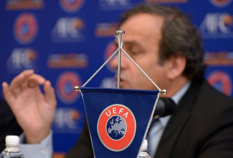 UEFA president Michel Platini speaks to the media in Malaysia. The Frenchman said goal-line referees, used in various UEFA competitions since 2009, were a cheaper way of determining whether the ball had crossed the line and warned against allowing technology to encroach on the game