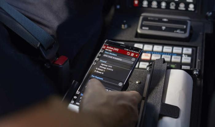 Office holding phone over in-car computer