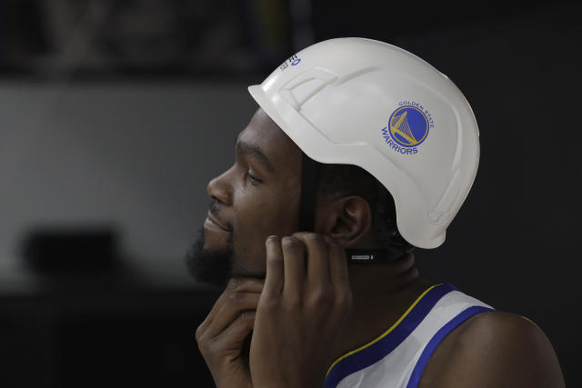"""<p>Kevin Durant: """"This helmet protects me from all the Twitter trolls."""" <br>Cameraman: """"OK, cupcake.""""<br>(AP) </p>"""