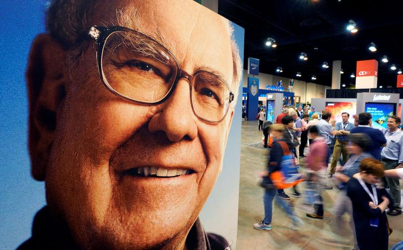 FILE PHOTO: Shareholders walk through the exhibit hall at the Berkshire Hathaway Inc annual meeting, the largest in corporate America, in its hometown of Omaha