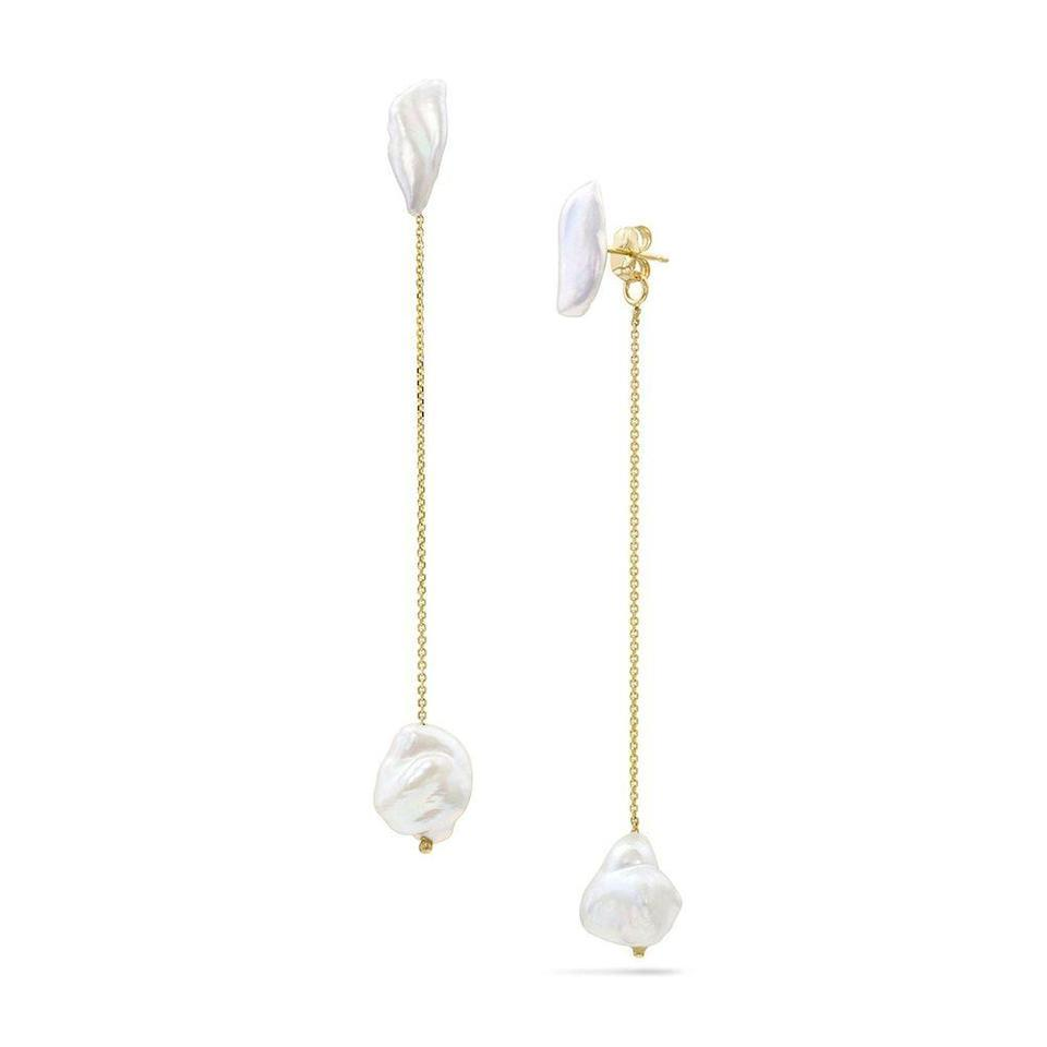 """<p><strong>White Space</strong></p><p>whitespacejewelry.com</p><p><strong>$498.00</strong></p><p><a href=""""https://www.whitespacejewelry.com/collections/gifts-under-500/products/lagniappe-drops"""" rel=""""nofollow noopener"""" target=""""_blank"""" data-ylk=""""slk:Shop Now"""" class=""""link rapid-noclick-resp"""">Shop Now</a></p><p>Like many of the brands listed here, this California jeweler uses recycled gold and conflict-free stones. Each piece is made by hand in designer Khadijah Fulton's studio or in partnership with small manufacturers and artisans in Los Angeles. </p>"""