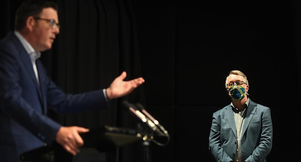 Victoria's Health Minister Martin Foley (right) at a press conference with Daniel Andrews (left)