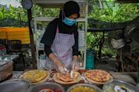A Malaysian family made their own oven to roll out a few dozen pizzas in time for the holy month of Ramadan in April in the Muslim-majority country