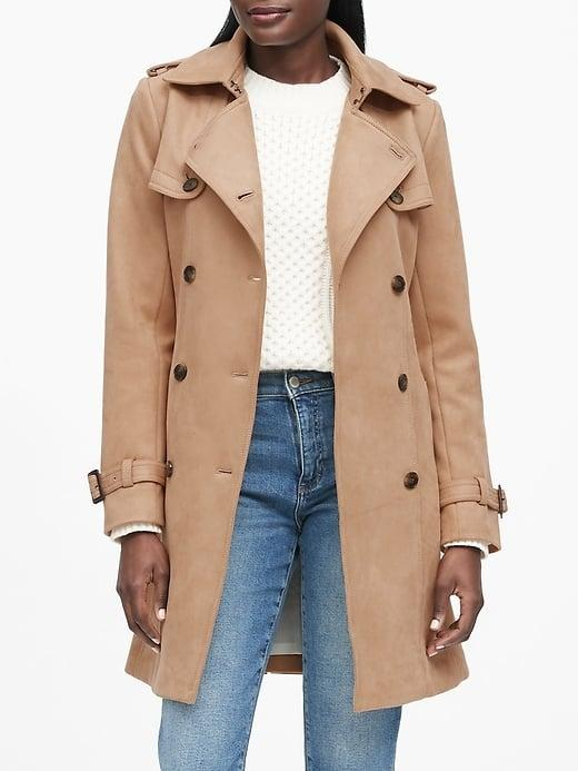 """<p>This statement <a href=""""https://www.popsugar.com/buy/Banana-Republic-Vegan-Suede-Trench-Coat-501137?p_name=Banana%20Republic%20Vegan%20Suede%20Trench%20Coat&retailer=bananarepublic.gap.com&pid=501137&price=249&evar1=fab%3Auk&evar9=46758398&evar98=https%3A%2F%2Fwww.popsugar.com%2Ffashion%2Fphoto-gallery%2F46758398%2Fimage%2F46758408%2FBanana-Republic-Vegan-Suede-Trench-Coat&list1=shopping%2Cbanana%20republic%2Ccoats%2Cwinter%2Couterwear%2Cwinter%20fashion&prop13=api&pdata=1"""" rel=""""nofollow"""" data-shoppable-link=""""1"""" target=""""_blank"""" class=""""ga-track"""" data-ga-category=""""Related"""" data-ga-label=""""https://bananarepublic.gap.com/browse/product.do?pid=494428012&amp;cid=1078664&amp;pcid=99915&amp;vid=1&amp;grid=pds_43_102_1#pdp-page-content"""" data-ga-action=""""In-Line Links"""">Banana Republic Vegan Suede Trench Coat</a> ($249) is a choice you can feel good about.</p>"""