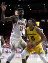 California forward Roman Davis drives on Arizona forward Deandre Ayton (13) during the first half of an NCAA college basketball game Saturday, March 3, 2018, in Tucson, Ariz. (AP Photo/Rick Scuteri)