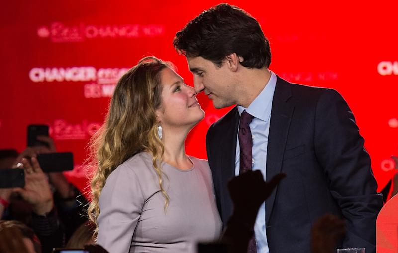Justin Trudeau kisses his wife after winning the Canadian general election in October 2015 (AFP Photo/Nicholas Kamm)