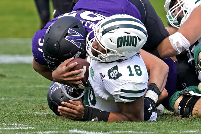 Ohio quarterback Armani Rogers (18) is sacked by Northwestern defensive lineman Sean McLaughlin during the second half of an NCAA college football game in Evanston, Ill., Saturday, Sept. 25, 2021. Northwestern won 35-6. (AP Photo/Nam Y. Huh)