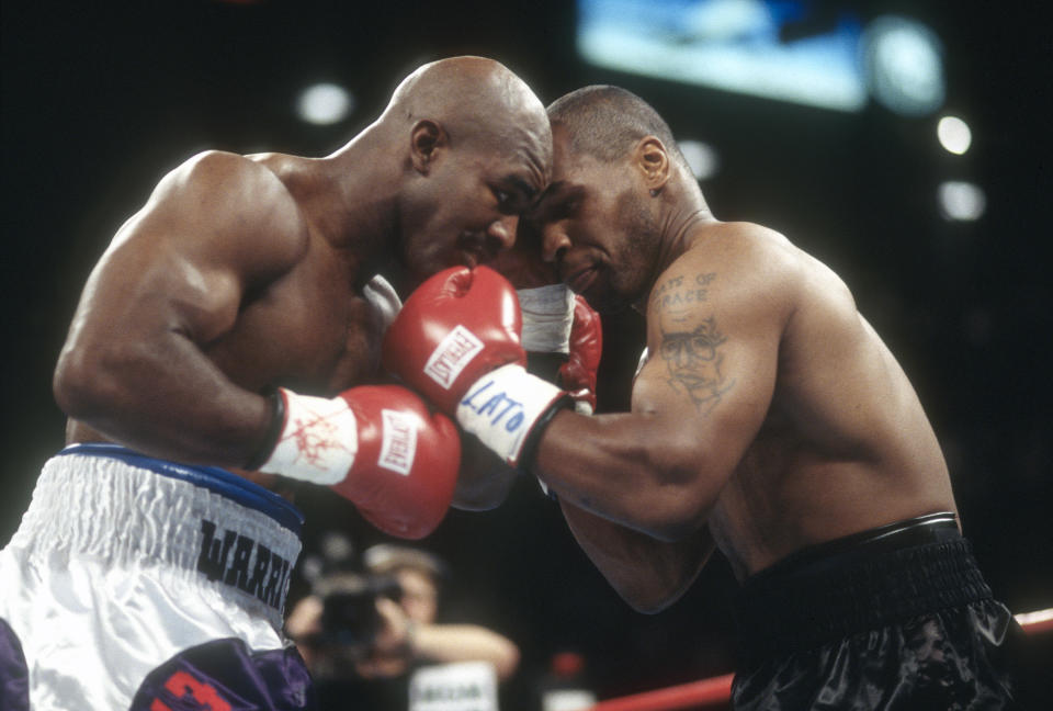 Evander Holyfield and Mike Tyson fight for WBA World Heavyweight Title on June 28,1997 at the MGM Grand Garden in Las Vegas, Nevada. The Fight was stop in the third round and Tyson was disqualified for biting Holyfield on both ears. (Photo by Focus on Sport/Getty Images)